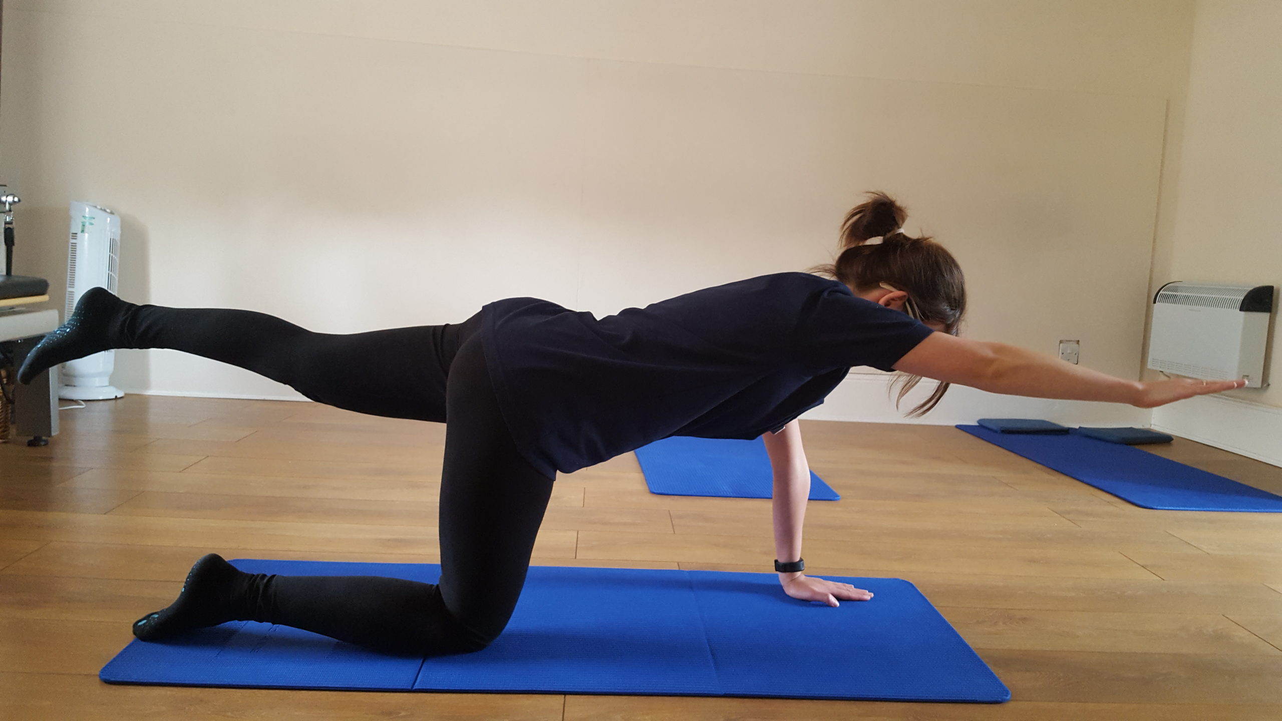 swim lane end pilates for back pain - Woodside Clinic osteopathy pilates in Leighton Buzzard